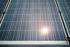 Closeup on solar panels with reflection of the sun. Above Stock Photography