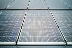 Closeup on solar panels on roof generate electricity Stock Photos