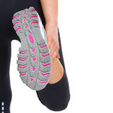 Closeup on sole of stretching fitness woman Stock Photography