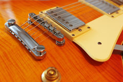 Closeup of solid body electric guitar. Detail, selective focus. Royalty Free Stock Photo