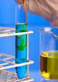 Closeup of solutions mixing in a test tube Royalty Free Stock Photo