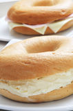 Stuffed bagels. Closeup of some bagels, one filled with cream cheese, and another with ham and cheese Royalty Free Stock Photography
