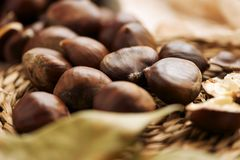 Chestnuts on a table Stock Photos