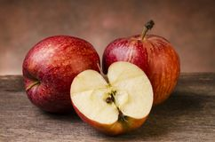 Still life. red apples on rustic table. Closeup of some fresh red apples on rustic wooden background.still life royalty free stock images
