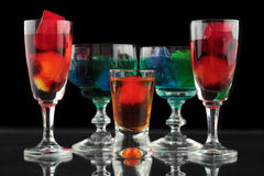 Closeup of some glasses with cocktails of different colors in nightclub.  Stock Photos