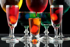 Closeup of some glasses with cocktails of different colors in nightclub.  Royalty Free Stock Photography
