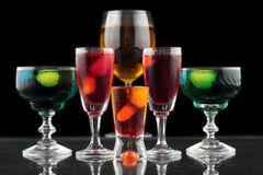Closeup of some glasses with cocktails of different colors in nightclub.  Royalty Free Stock Images