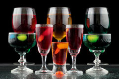 Closeup of some glasses with cocktails of different colors in nightclub.  Stock Photo