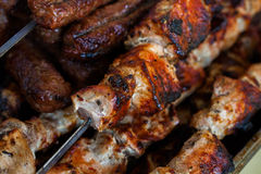 The closeup of some meat skewers being grilled in a barbecue. grilled meat skewers, barbecue Royalty Free Stock Photography