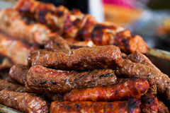 The closeup of some meat skewers being grilled in a barbecue. grilled meat skewers, barbecue Stock Photography