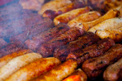 The closeup of some meat skewers being grilled in a barbecue. grilled meat skewers, barbecue Stock Image