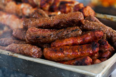 The closeup of some meat skewers being grilled in a barbecue. grilled meat skewers, barbecue Royalty Free Stock Photos