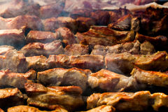 The closeup of some meat skewers being grilled in a barbecue. grilled meat skewers, barbecue Royalty Free Stock Photo