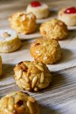 Panellets, typical confection of Catalonia, Spain. Closeup of some panellets, typical confection eaten in All Saints Day in Catalonia, Spain, on a wooden table Royalty Free Stock Photography