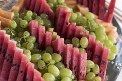 Closeup of some pieces of watermelon,. Grapes and melon fresh royalty free stock photos