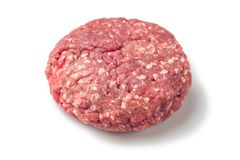 Closeup of some raw burgers on a white background. Raw red meat burger for hamburgers of minced ground beef or pork ready for cooking isolated on white Stock Images