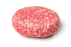 Closeup of some raw burgers on a white background. Raw red meat burger for hamburgers of minced ground beef or pork ready for cooking isolated on white Royalty Free Stock Images