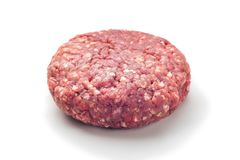 Closeup of some raw burgers on a white background. Raw red meat burger for hamburgers of minced ground beef or pork ready for cooking isolated on white Stock Photo