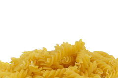 Closeup of some raw fusilli. On white background Royalty Free Stock Photo