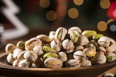 Closeup of some roasted pistachio on rustic old wooden table. Closeup of some roasted pistachio on rustic old wooden table Royalty Free Stock Image