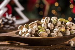 Closeup of some roasted pistachio on rustic old wooden table. Closeup of some roasted pistachio on rustic old wooden table Royalty Free Stock Photo