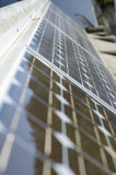 Closeup of some solar panels reflecting surroundings. Solar panels soaking in sun rays and reflecting surroundings Stock Photo