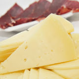 Spanish serrano ham and manchego cheese tapas. Closeup of some spanish serrano ham and manchego cheese tapas Stock Photography