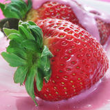 Strawberries in strawberry yoghurt Royalty Free Stock Photos
