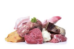 Meat to prepare escudella, typical of Catalonia. Closeup of some uncooked pieces and products of chicken, beef and pork meat to prepare escudella, a soup typical Stock Photography