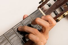 Closeup of someone playing the guitar, hand strings. Closeup of someone playing the guitar, hand and strings Stock Image