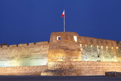 Closeup of the Southern tower of Arad Fort during blue hours. Arad Fort is a 15th century fort in Arad, Bahrain Stock Photo