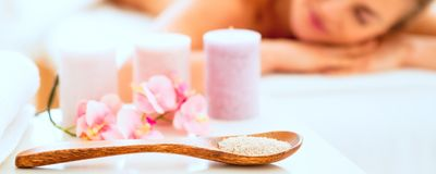 Closeup on spa therapy ingredients and relaxed woman in ba Stock Images