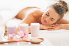 Closeup on spa therapy ingredients and woman in background Stock Images