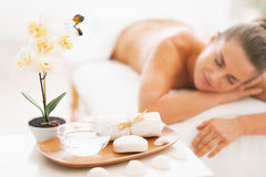 Closeup on spa therapy ingredients and young woman in background Stock Photography