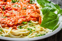 Closeup of spaghetti bolognese with shrimps Stock Photos