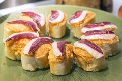 Closeup spanish tapas of serrano ham, basque cuisine. Stock Photos
