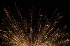 Closeup of a sparkler on black background Stock Photos