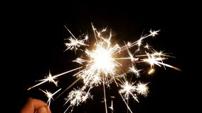 Sparkling Cold Fireworks in Hand. Closeup Sparkling Cold Fireworks in Hand stock photography