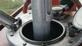 Closeup Special Metal Tool Put into Metal Reservoir stock video footage