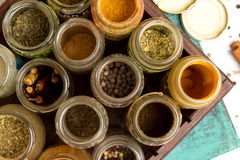 Closeup spices and herbs jars. Food, cuisine ingredients. Wooden box. Stock Photo