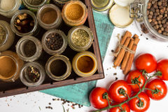 Closeup spices and herbs jars. Food, cuisine ingredients. Wooden box. Stock Images