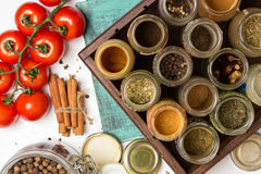 Closeup spices and herbs jars. Food, cuisine ingredients. Wooden box. Stock Image