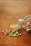 Closeup spilled jar candy canes Stock Images