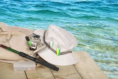 Closeup of spinning fishing equipment on a dock Royalty Free Stock Images