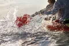 Closeup splashes of kayak canoe paddle sea bay. Closeup photo of splashes from kayak or canoe paddle at sea bay. Kayaking or canoeing concept stock photos