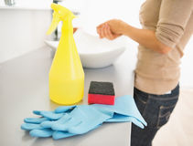 Closeup on sponge; gloves and spray bottle on desk Royalty Free Stock Images