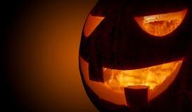 Closeup spooky halloween pumpkin shiny inside Stock Images