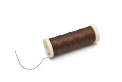 Closeup of a spool of brown thread isolated Stock Photos