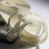 Closeup of a spool of film into a movie clapper and for film pro Royalty Free Stock Images