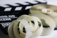 Closeup of a spool of film into a movie clapper and for film pro Stock Photos